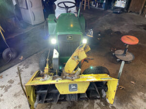 John Deere 112 with Snowblower, new headlights and the left wheel off